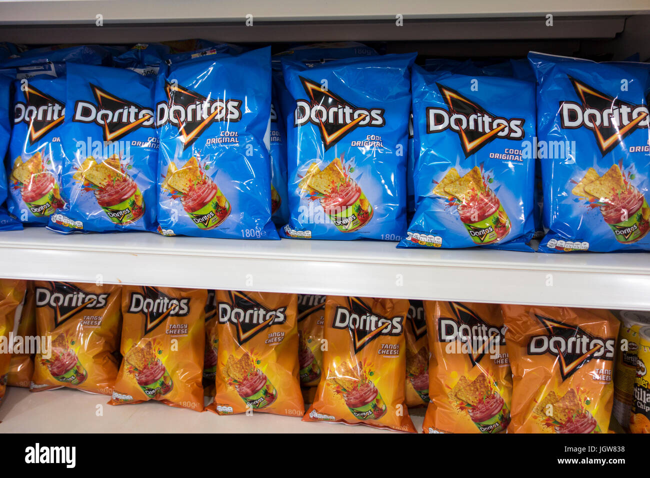 Bags of Doritos tortilla crisps for sale on a supermarket shelf in the UK - Stock Image