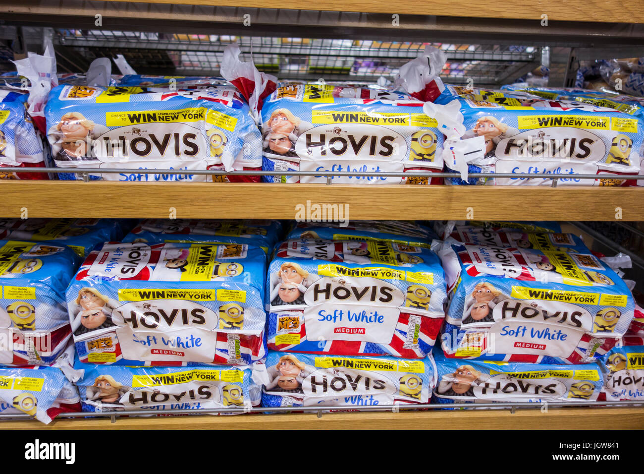 Packs of Hovis Soft White sliced bread for sale on a supermarket shelf in the UK - Stock Image