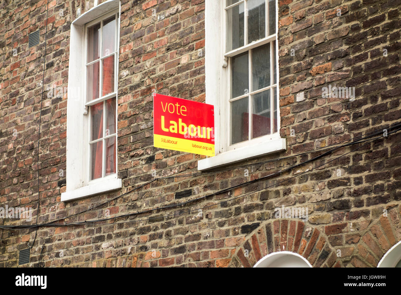Vote Labour sign outside a traditional London terrace house / terraced house, London, UK - Stock Image