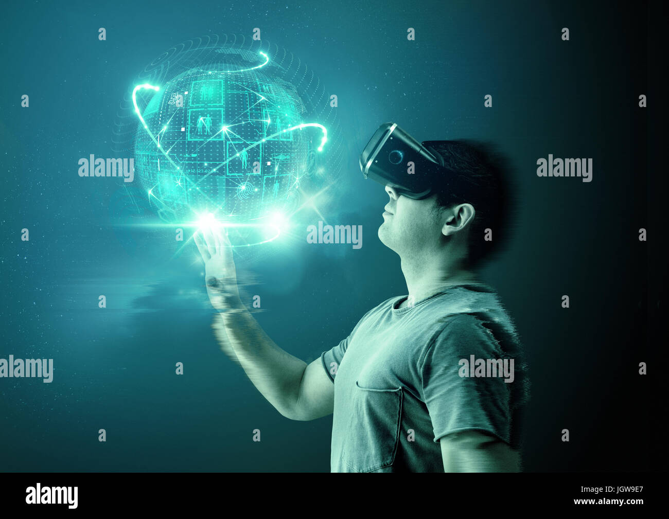 A young man wearing virtual reality (VR) goggles and headset with a projection of a digital world. - Stock Image