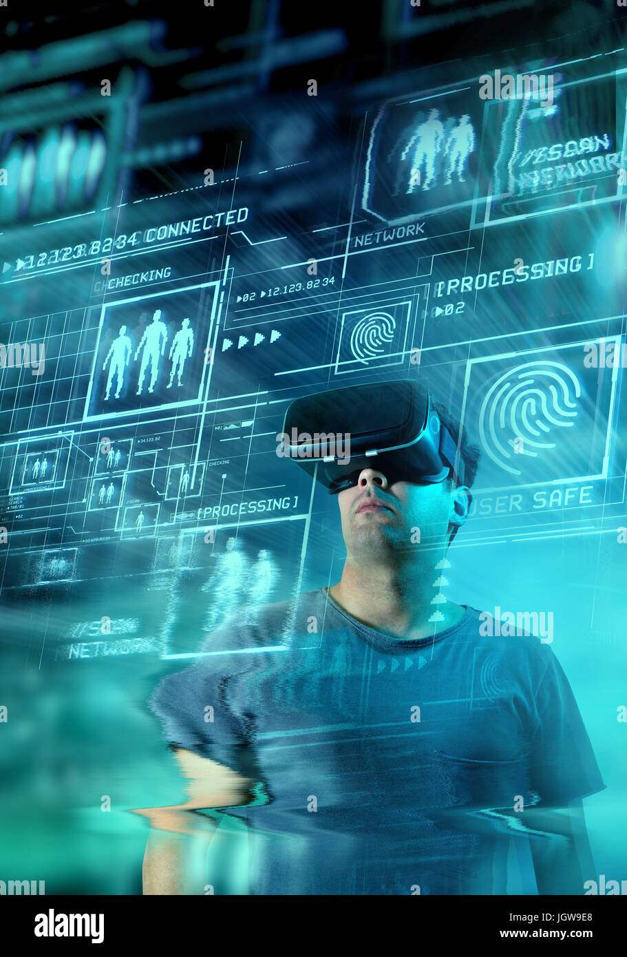 A young man wearing virtual reality (VR) goggles and headset with a projection of a digital information on display. - Stock Image