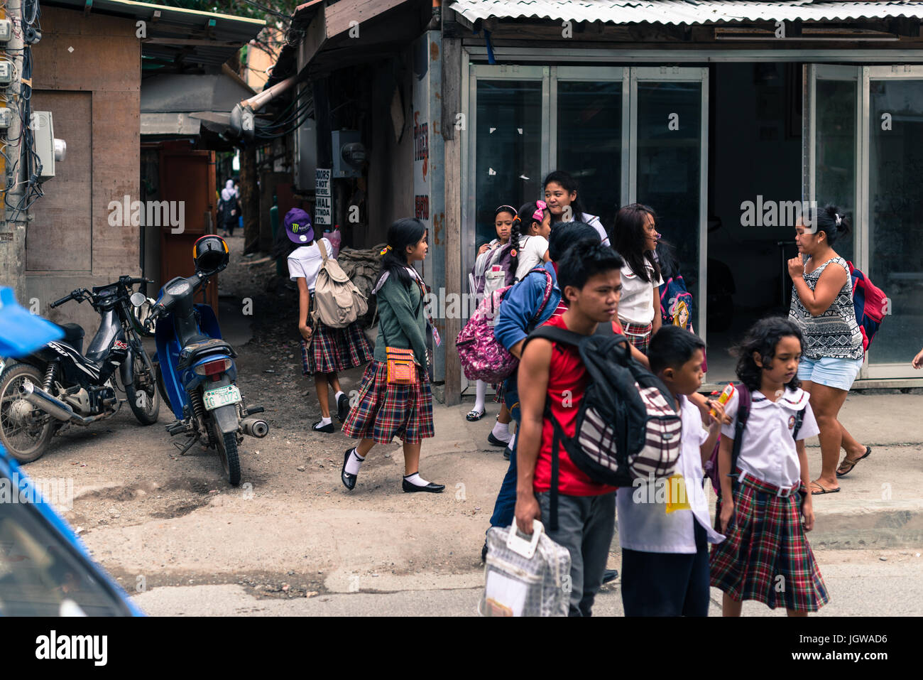 Filipino children coming back from school, dressed with skirts in Boracay, Philippines. - Stock Image