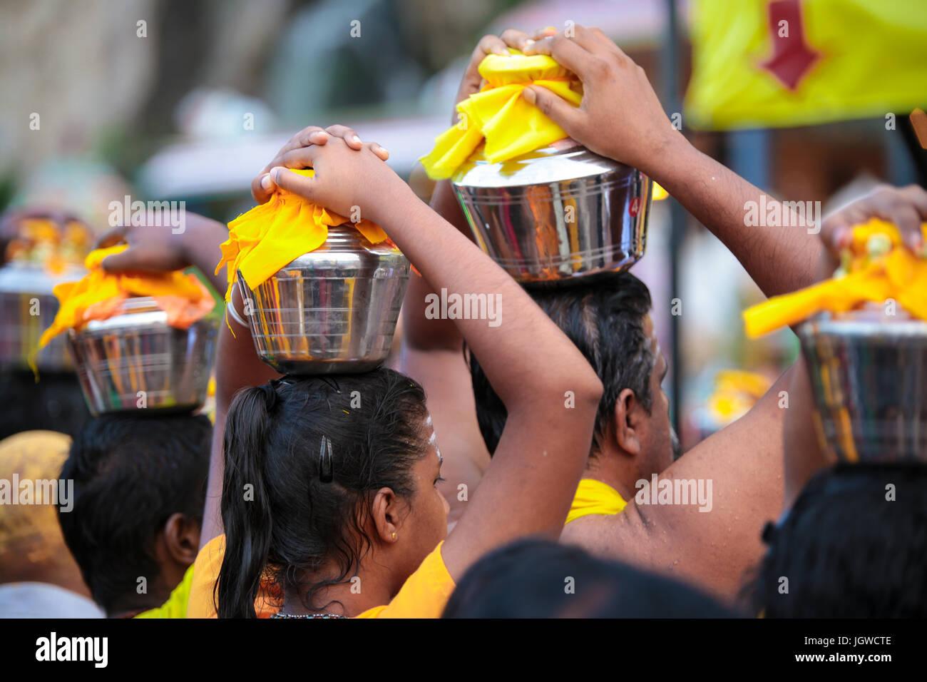 Hindu pilgrims with milk pot kavaldi queueing at batu cave temple, Kuala Lumpur Malaysia during Thaipusam festival Stock Photo