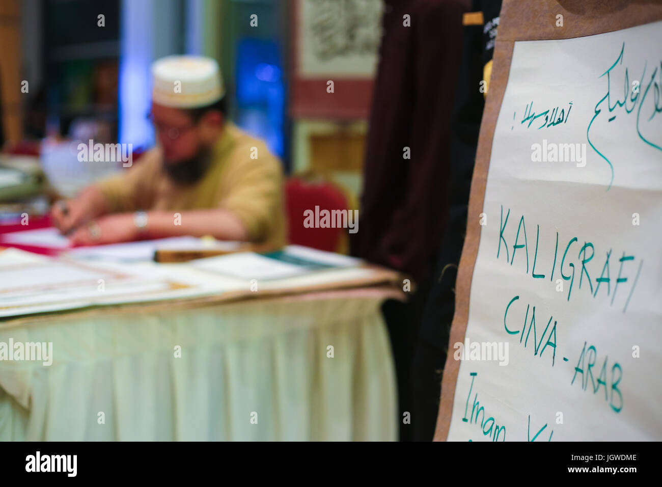 A muslim chinese scholar is showcasing islamic caligraphy during Putrajaya International Islamic Arts & Culture - Stock Image