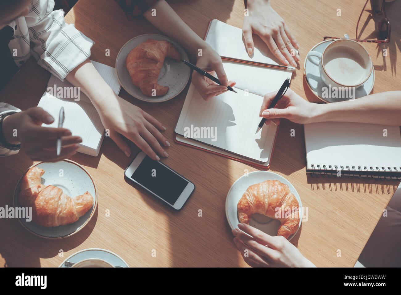 cropped view of people having lunch at meeting in cafe, business lunch concept - Stock Image