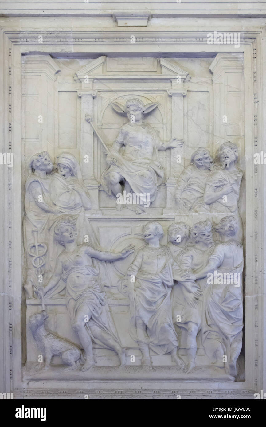 The Vices persecuting the Virtue. Stucco relief in the Antecabildo in the Seville Cathedral (Catedral de Sevilla) - Stock Image