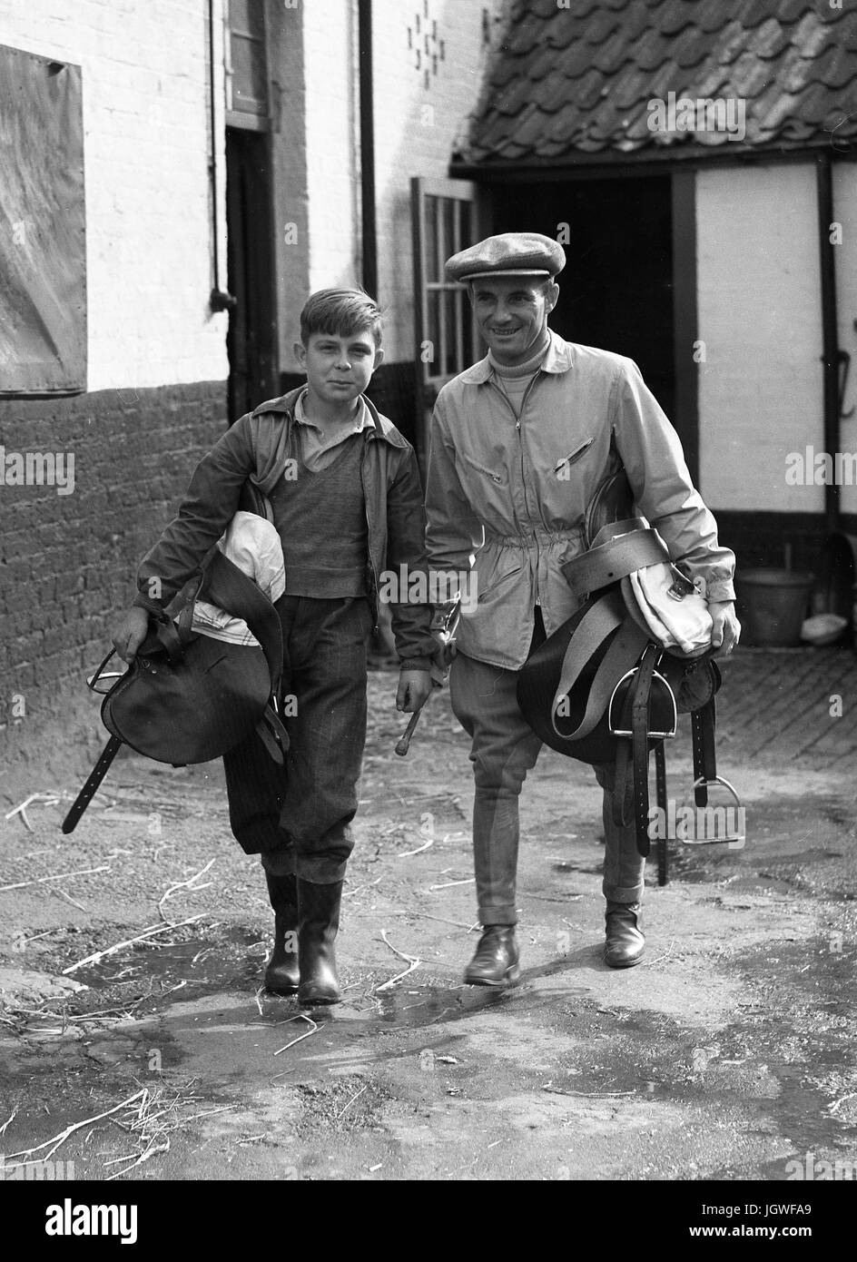 Jockey and stable lad at racing stables Britain 1950s - Stock Image