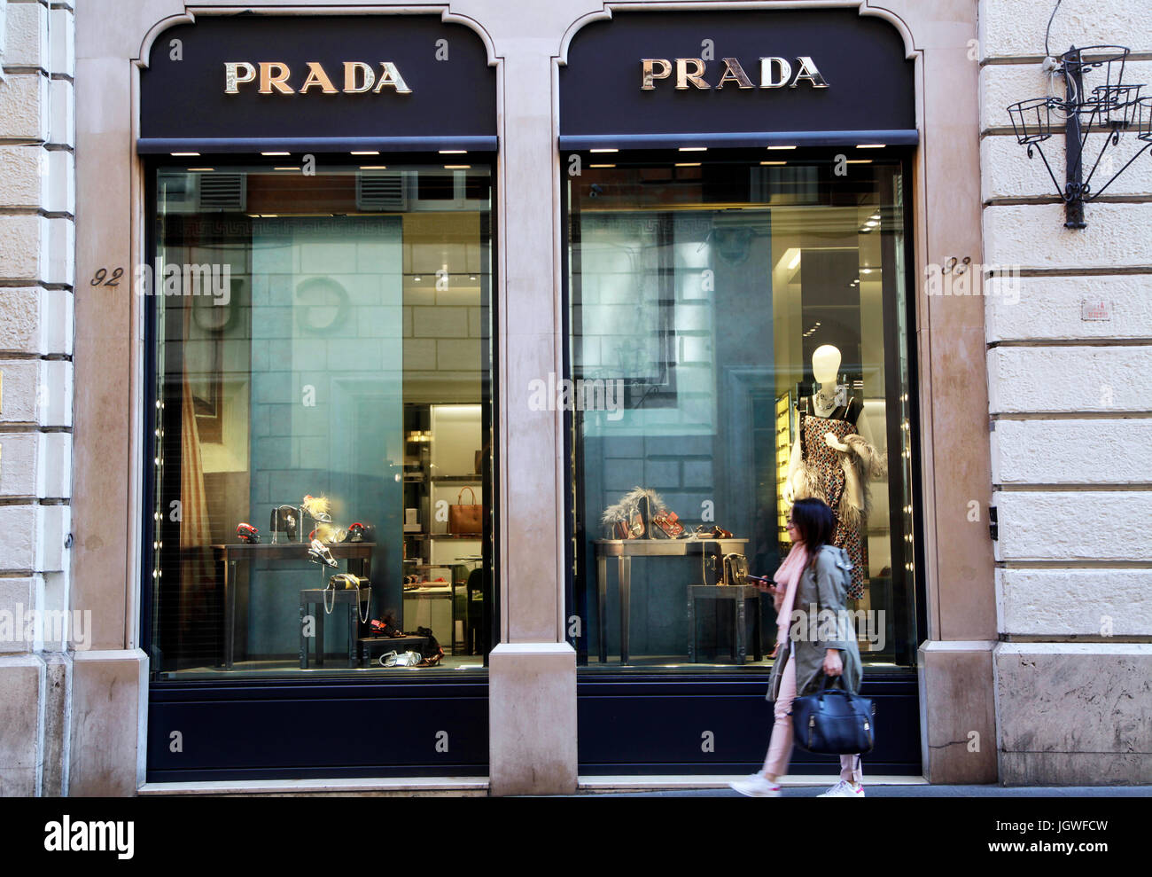 official photos 54411 78465 Pedestrians walk past of the shop window of Prada store in ...