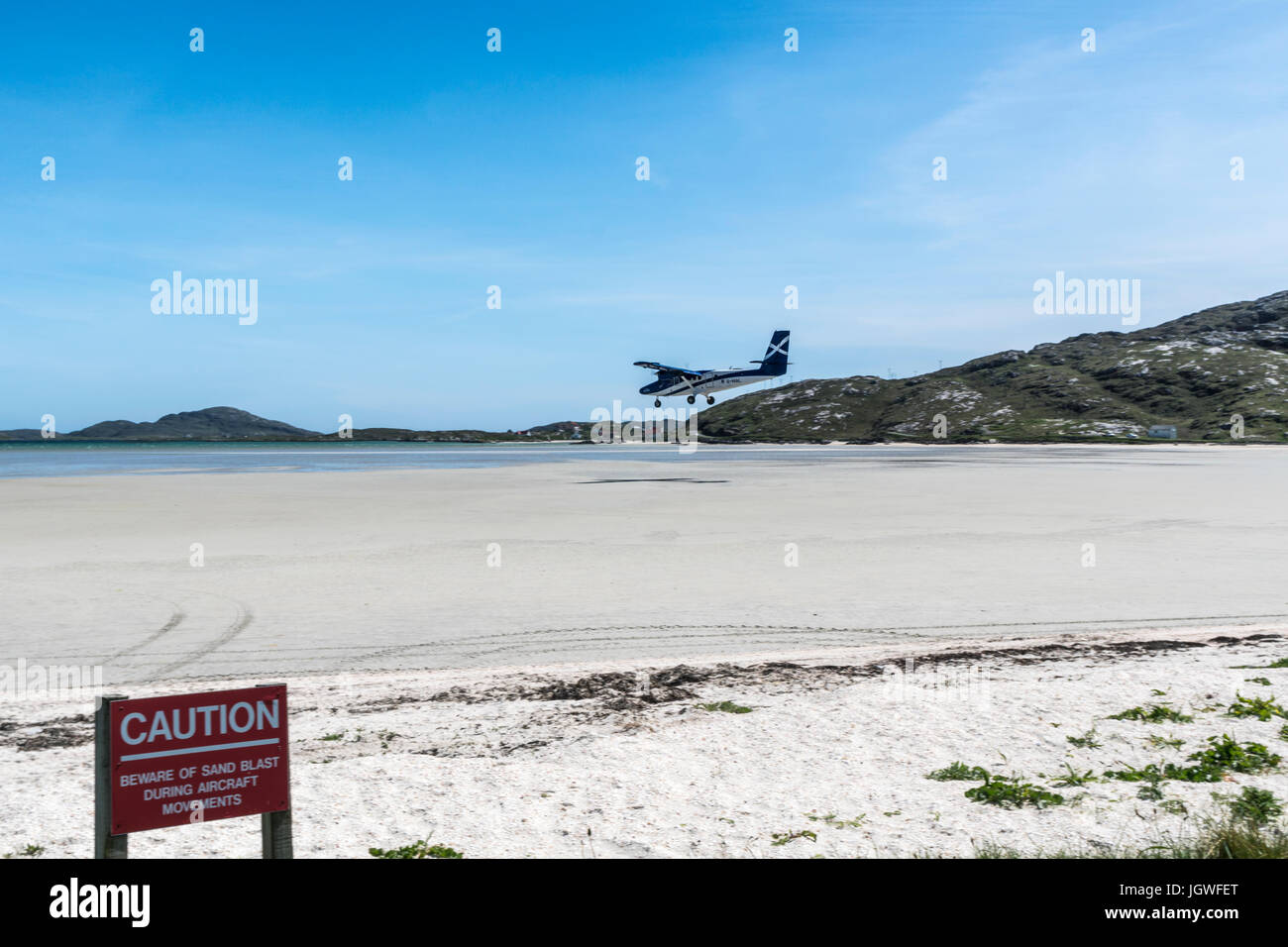 Twin Otter aircraft landing Barra Airport - Stock Image