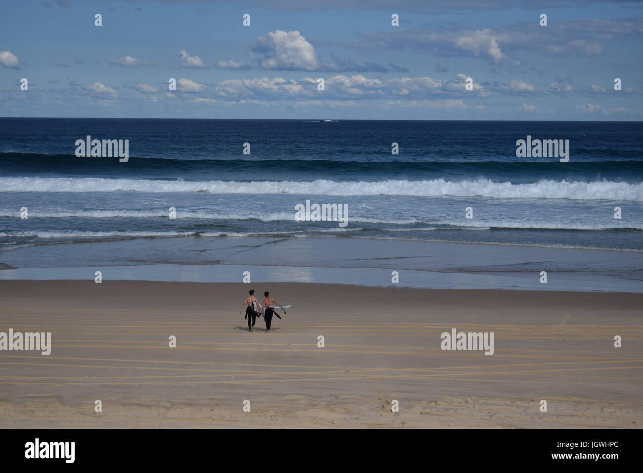 Two surfers on Australian Beach - Stock Image