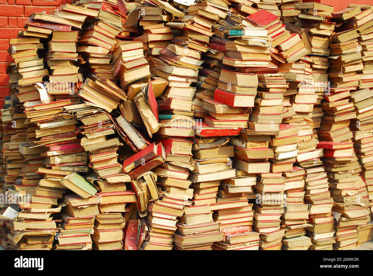A messy collection of used books - Stock Image