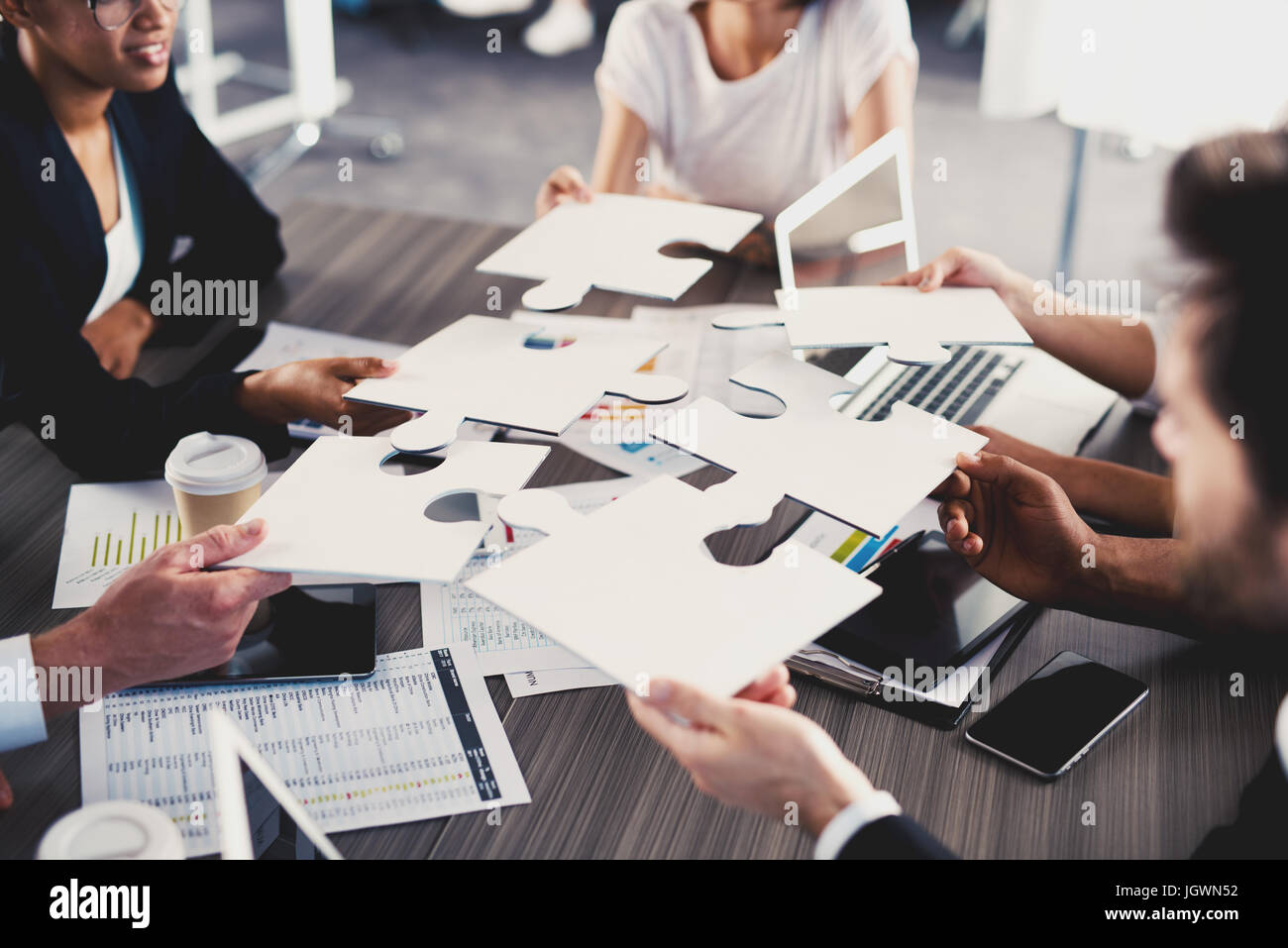 Team of businessmen work together for one goal. Concept of unity and partnership - Stock Image