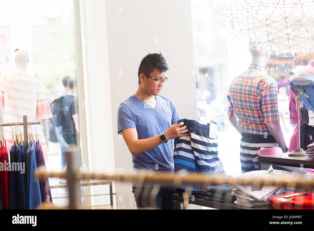 Young man clothes shopping - Stock Image