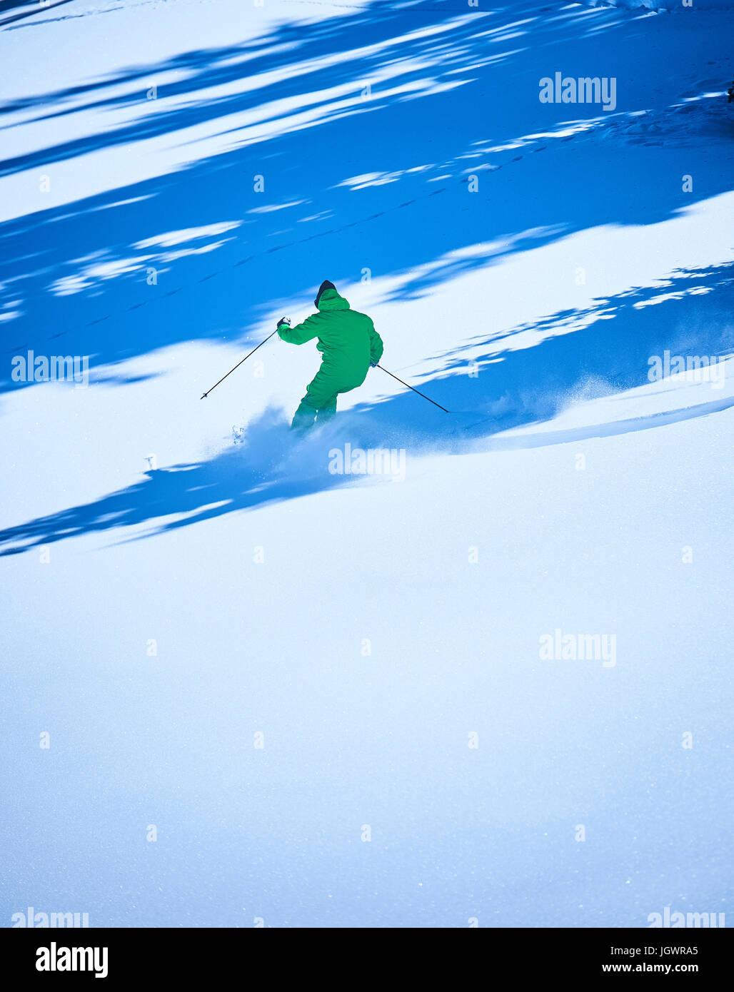 Man skiing in deep snow, Aspen, Colorado, USA - Stock Image