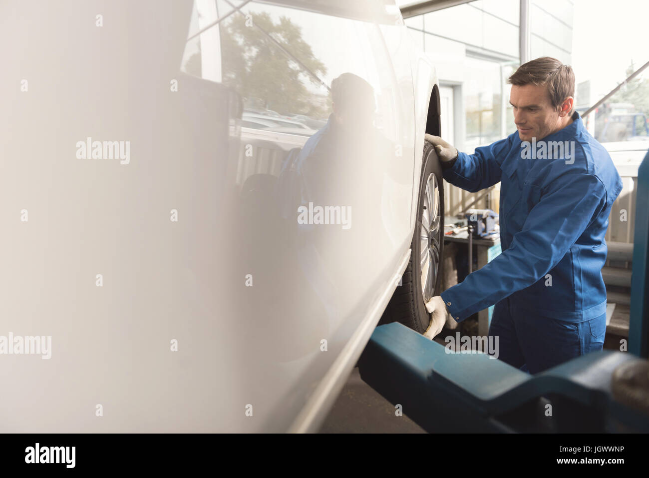 Real pro. Competent attentive hardworking specialist making sure autos parts working right after installing a new - Stock Image
