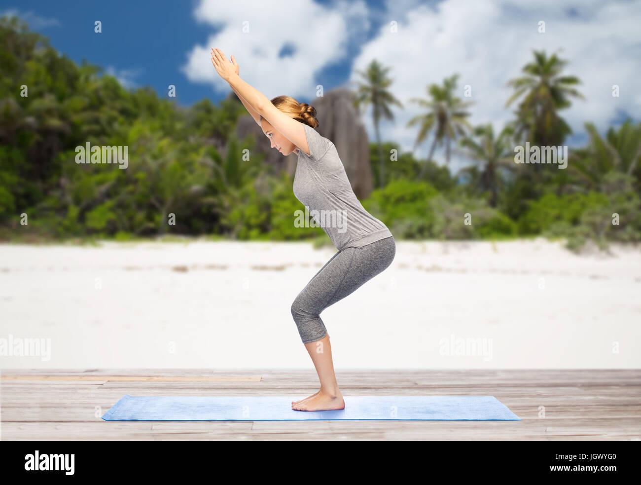 Woman Doing Yoga Chair Pose On Beach Stock Photo Alamy