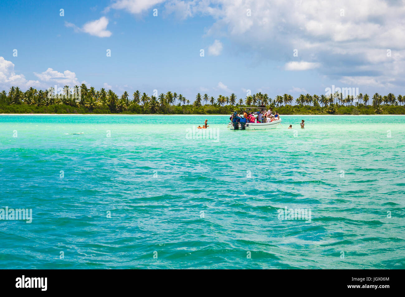 Boat with tourists in a natural sea pool. Dominican Republic. - Stock Image