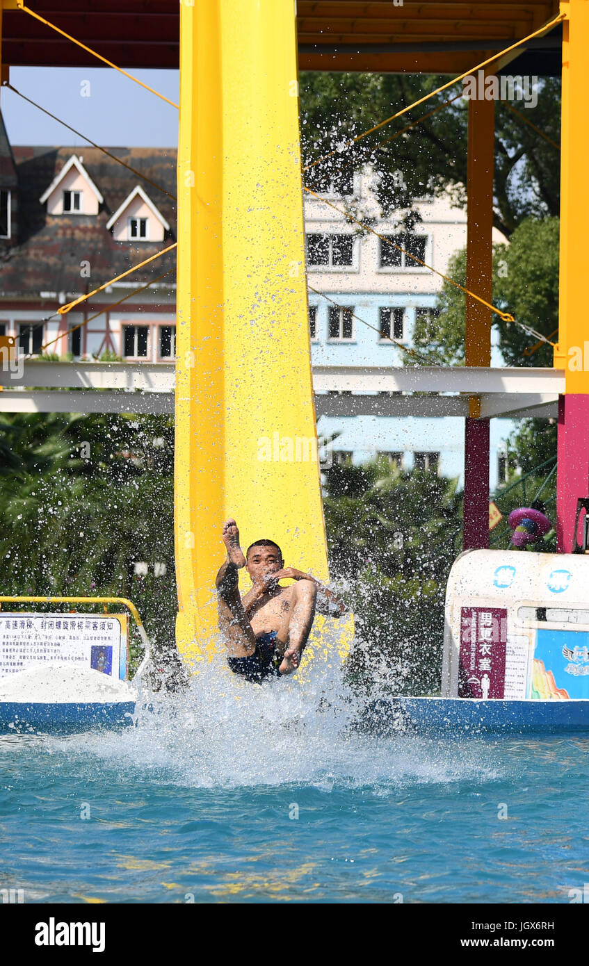 Chongqing, China. 11th Jul, 2017. Tourists played in water to keep cool in a water park in Chongqing, July 11, 2017. - Stock Image