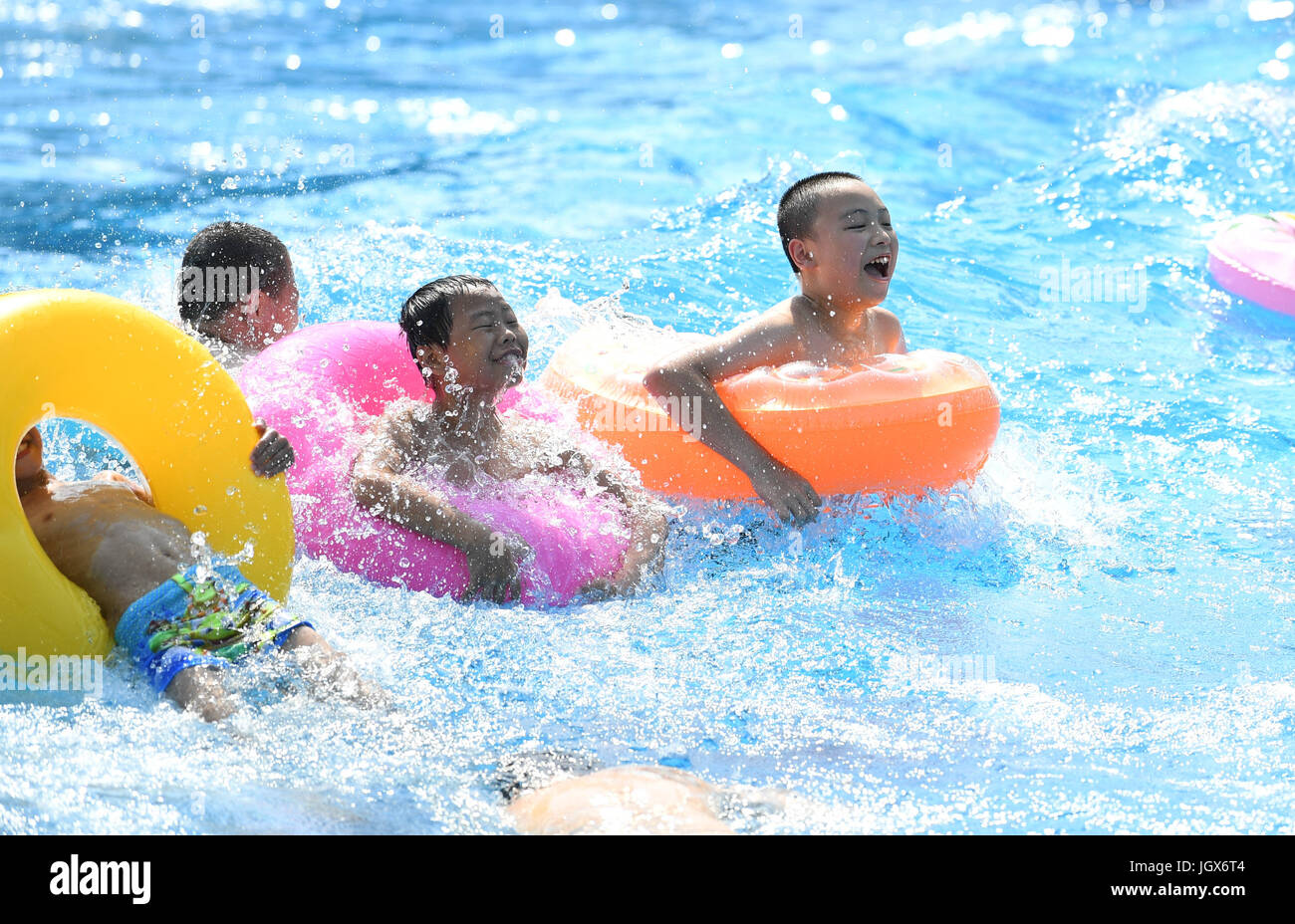 Chongqing, China. 11th Jul, 2017. Kids played in water to keep cool in a water park in Chongqing, July 11, 2017. - Stock Image