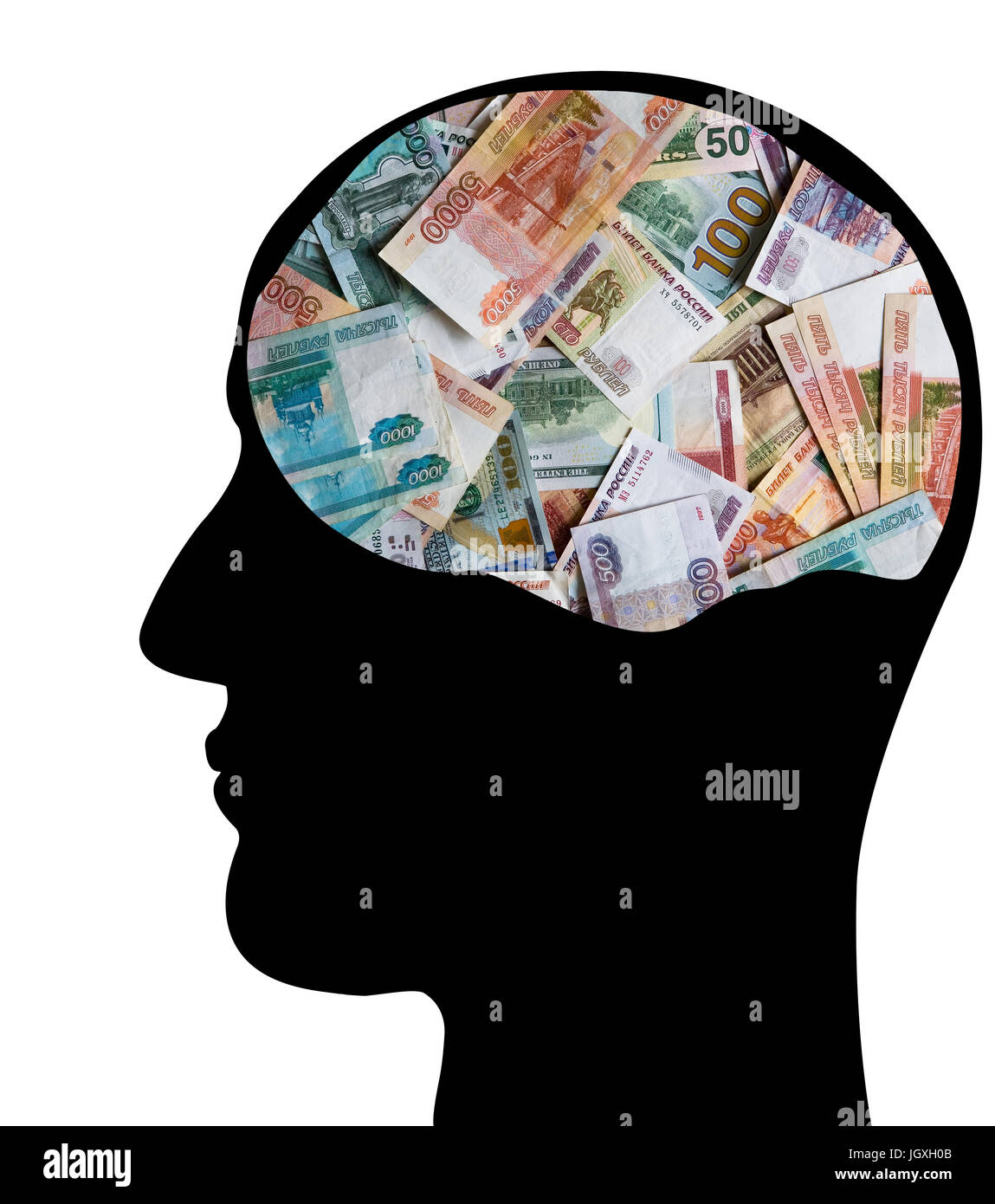 Profile of the head of a businessman. Many monetary denominations of different denominations. Rubles and dollars. - Stock Image
