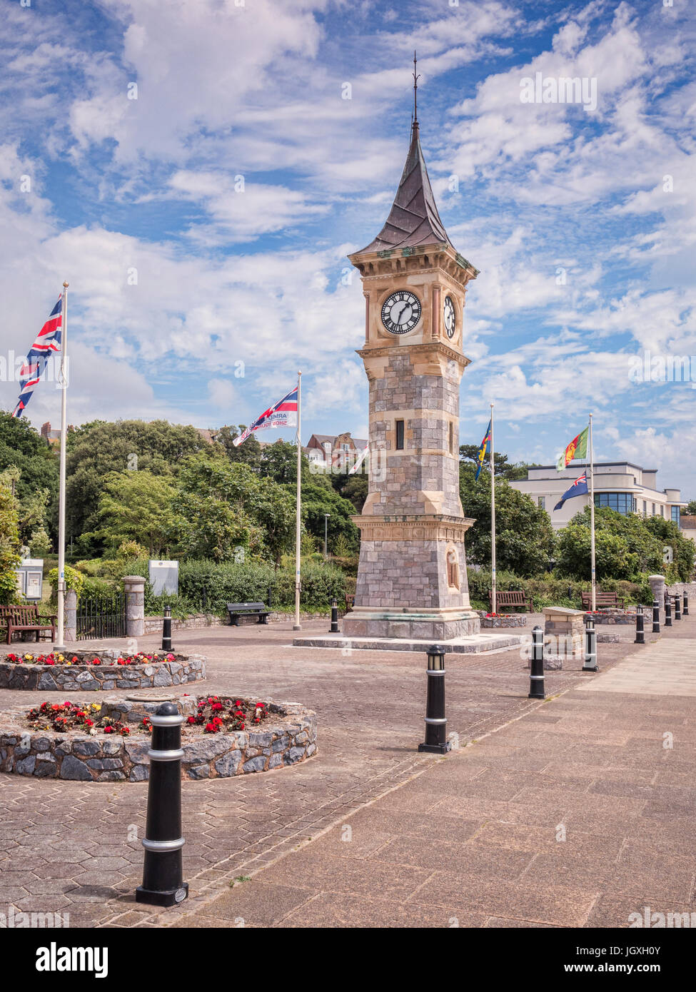 26 June 2017: Exmouth, Devon, UK - The Jubilee Clock Tower on the Esplanade at Exmouth, Devon, with flags flying - Stock Image