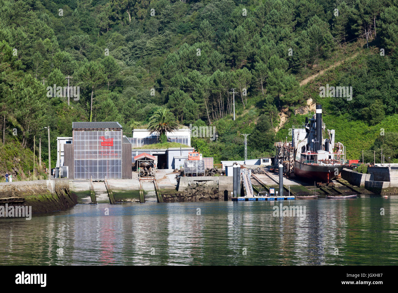 A bucket dredging ship in dry dock in the fjord of Pasajes (Guipuzkoa - Spain).  Pasajes (or Pasaia) is the San Stock Photo