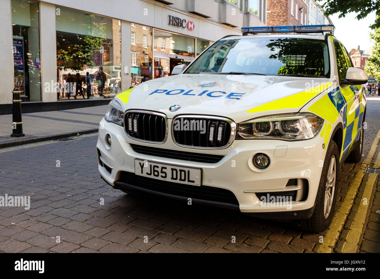 British police BMW parked outside a HSBC bank branch in the centre center of York, UK. - Stock Image