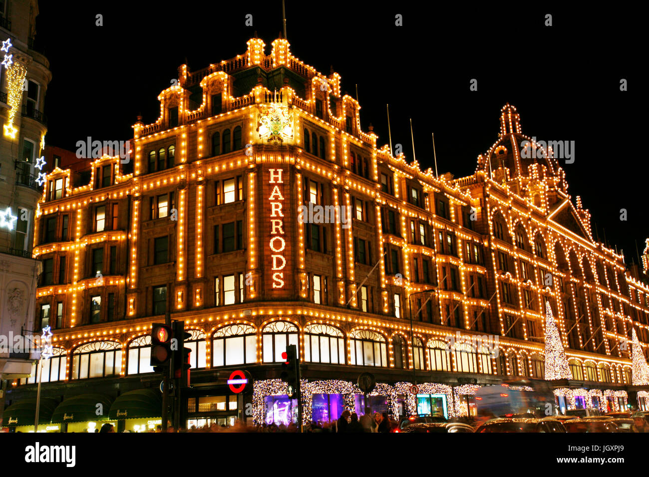 LONDON - DEC 8 : Night View of Harrods with christmas decoration on Dec 8, 2012, London, UK. This department store was opened at 1824 and now it is on Stock Photo