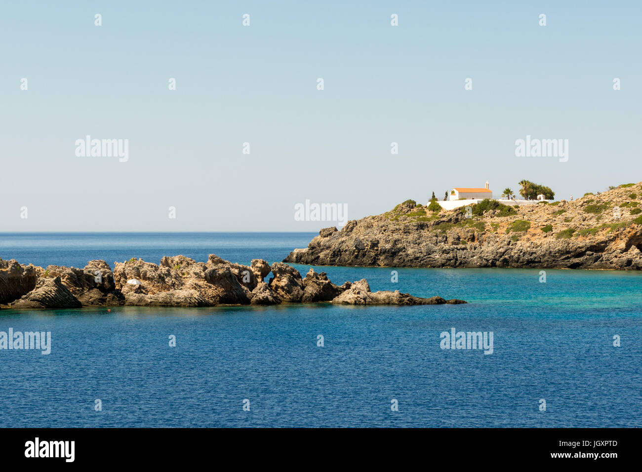 A sunbather finds solitude on a small islands of the south coast of western Crete, Greece, at Loutro. A solitary - Stock Image