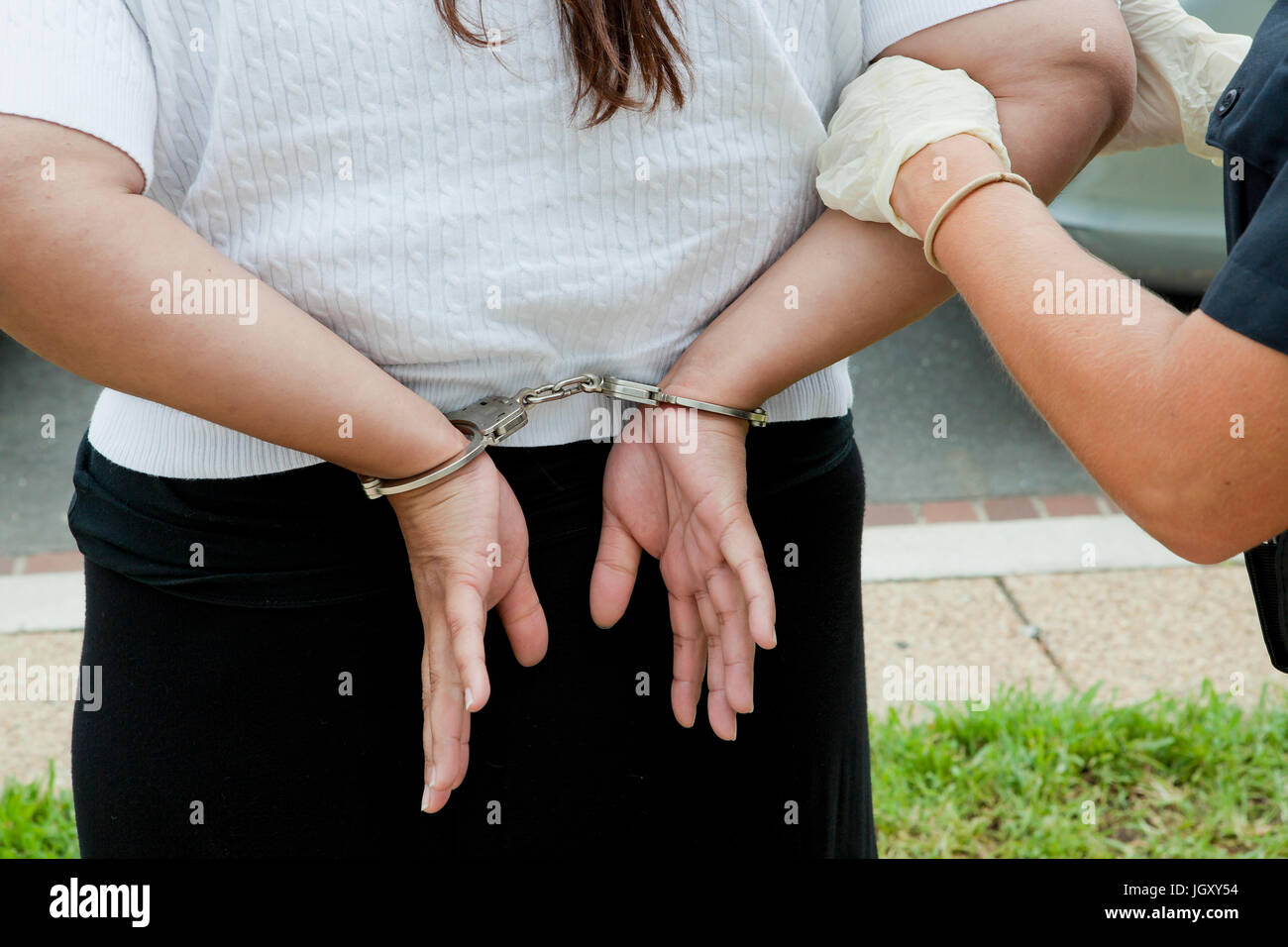 Woman handcuffed and arrested by police - USA - Stock Image