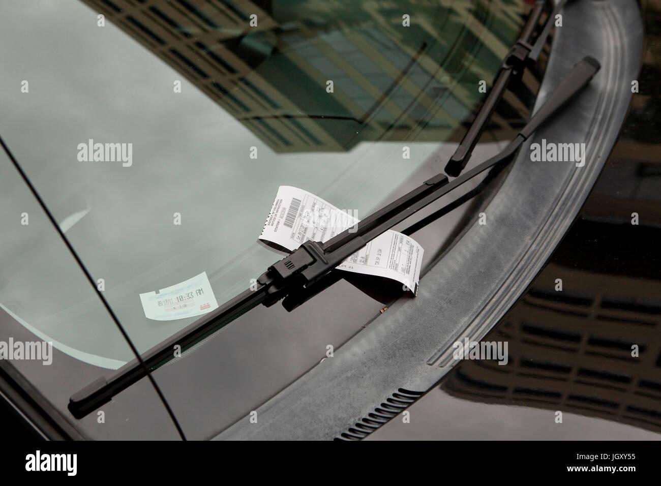 Parking violation ticket on windshield - USA - Stock Image