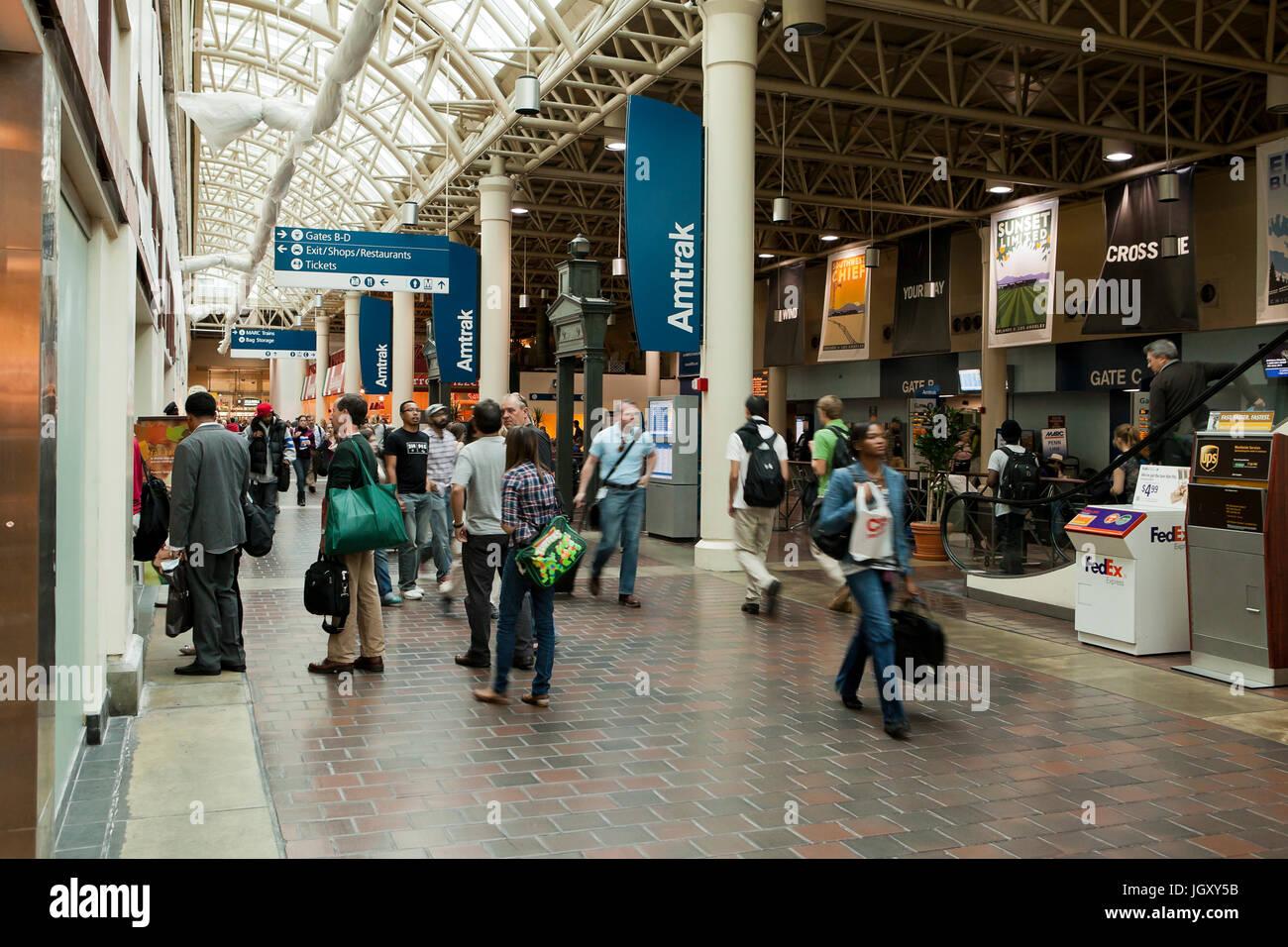 Travelers walking through Amtrak station at Union Station - Washington, DC USA - Stock Image