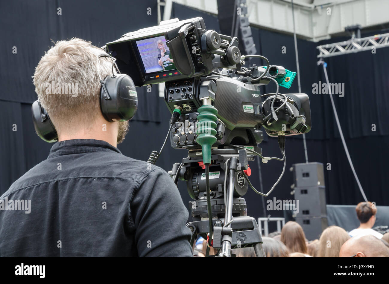 A cameraman from behind. - Stock Image