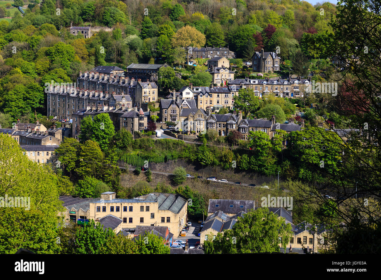 The steep sides of the Calder Valley in Hebden Bridge is dotted with terraced Victorian housing. - Stock Image