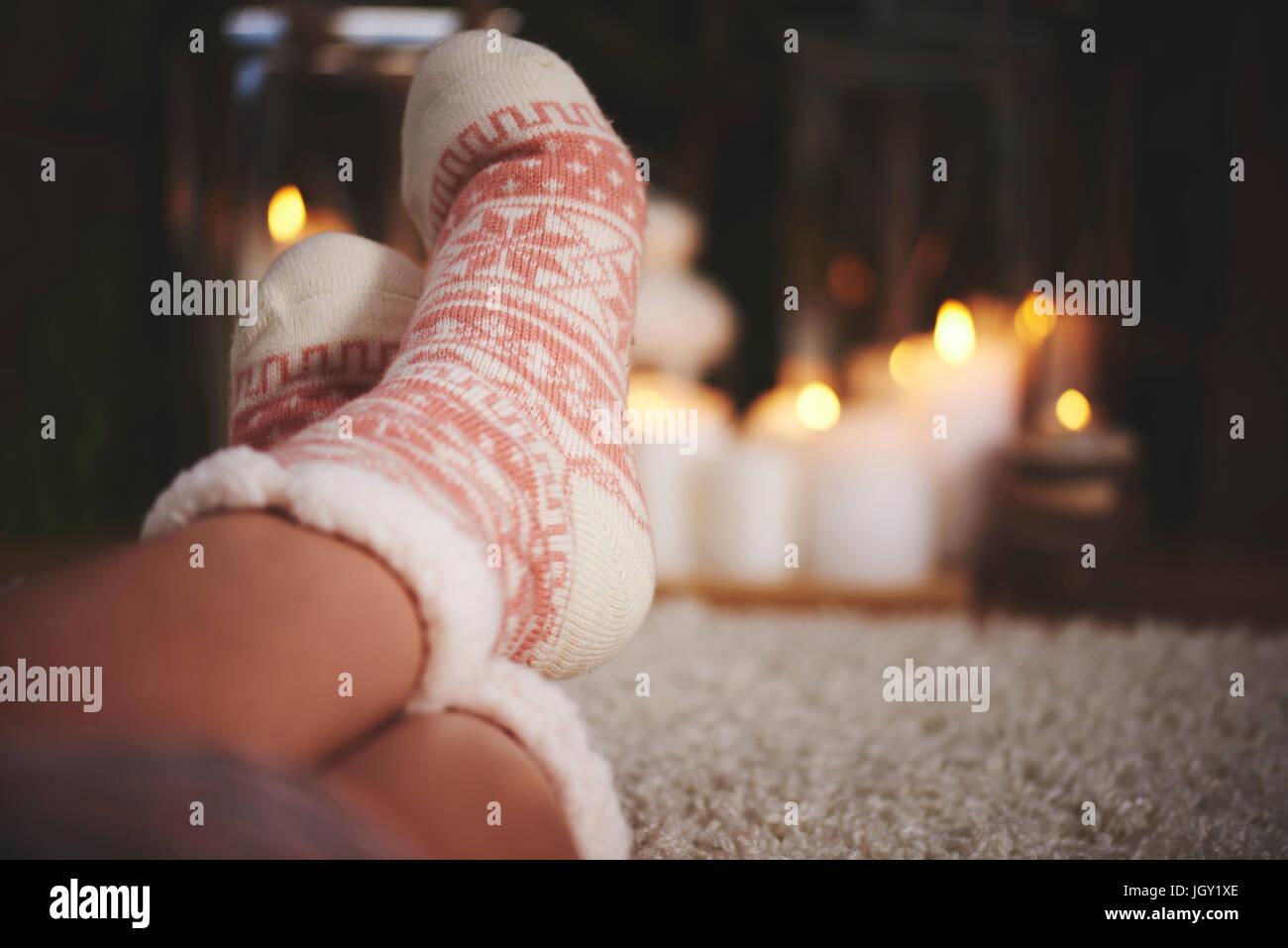 Feet of woman wearing festive socks - Stock Image