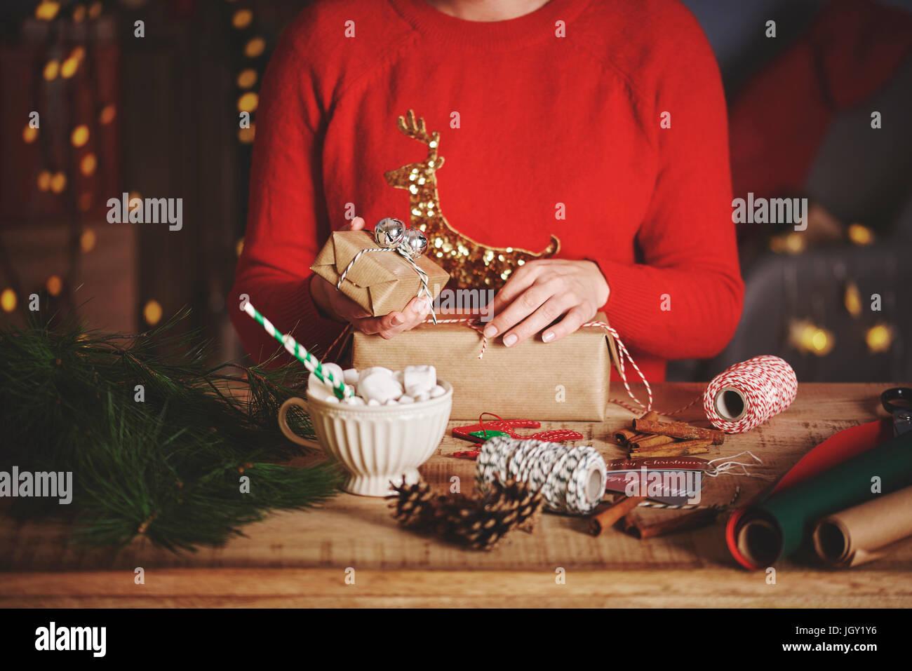 Woman wrapping christmas gifts Stock Photo: 148111690 - Alamy