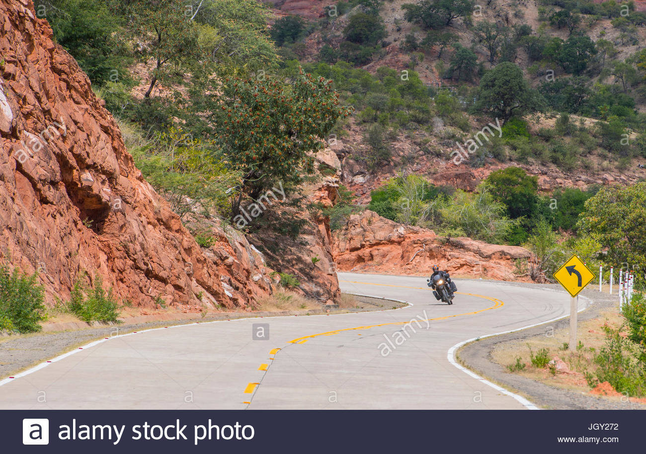 Man driving on touring motorbike, Potosi, Bolivia - Stock Image