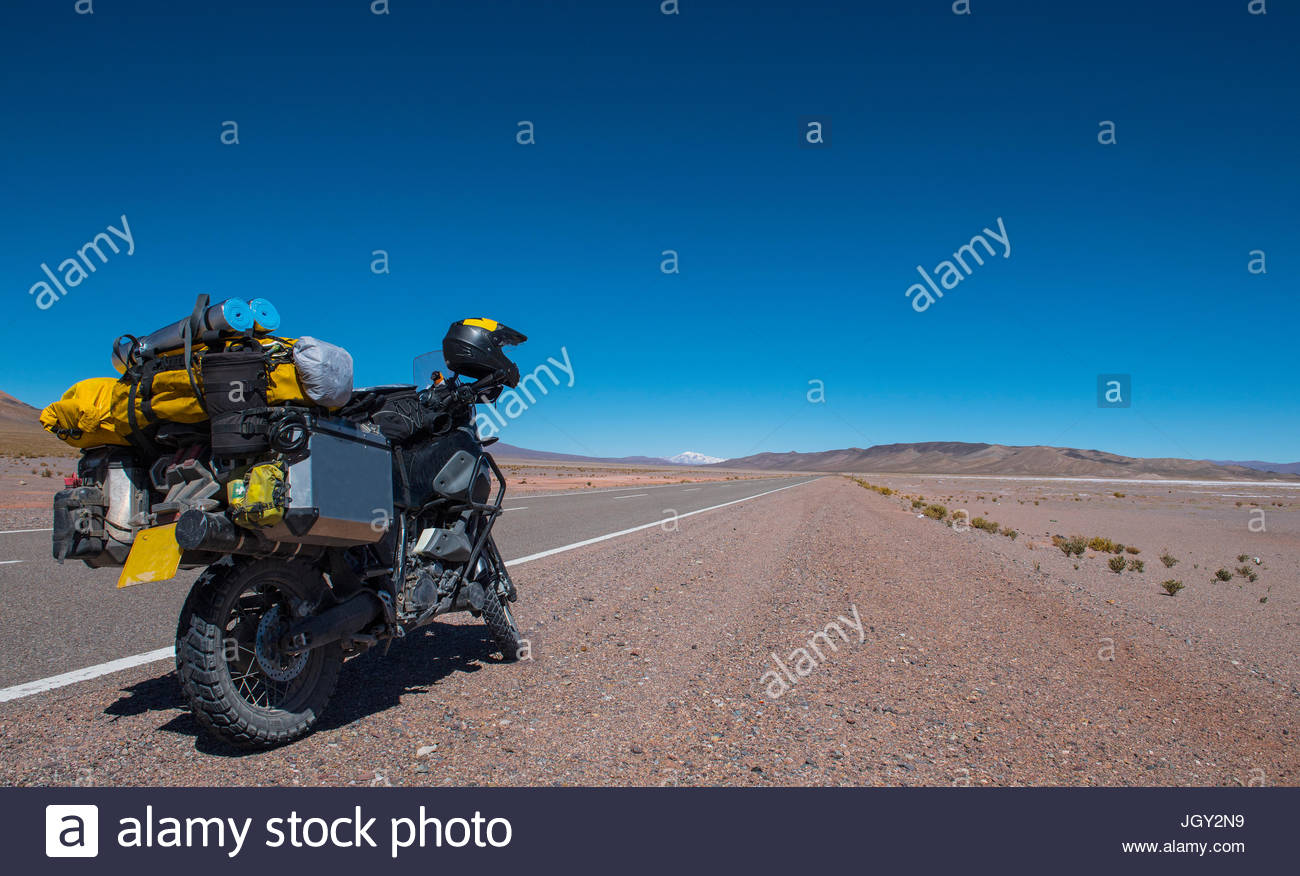 Touring motorbike parked at side of road, Reserva Nacional Los Flamencos national park, Antofagasta, Chile, South - Stock Image