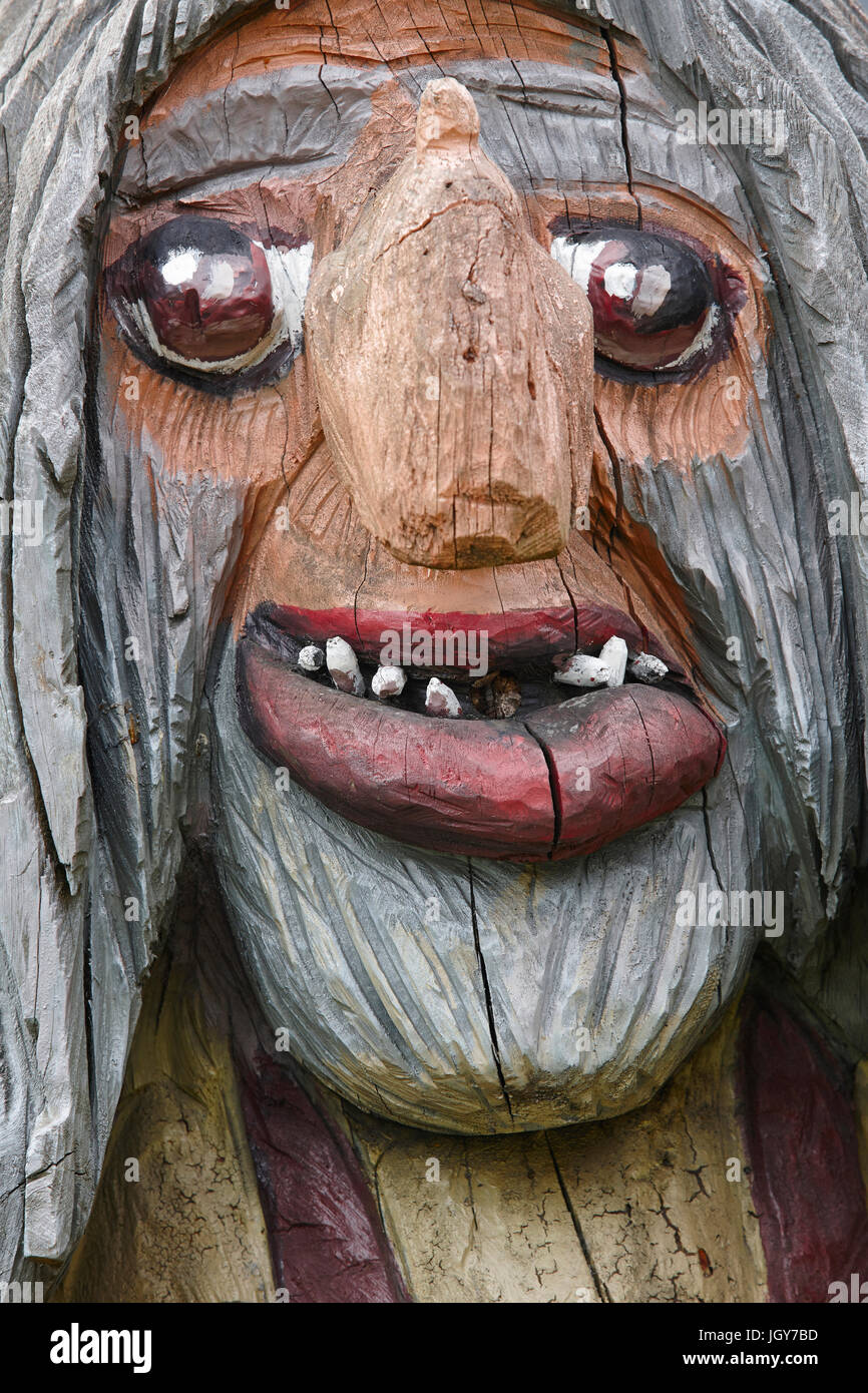 Norwegian carved wooden face detail troll. Scandinavian folklore. Norway. Vertical - Stock Image