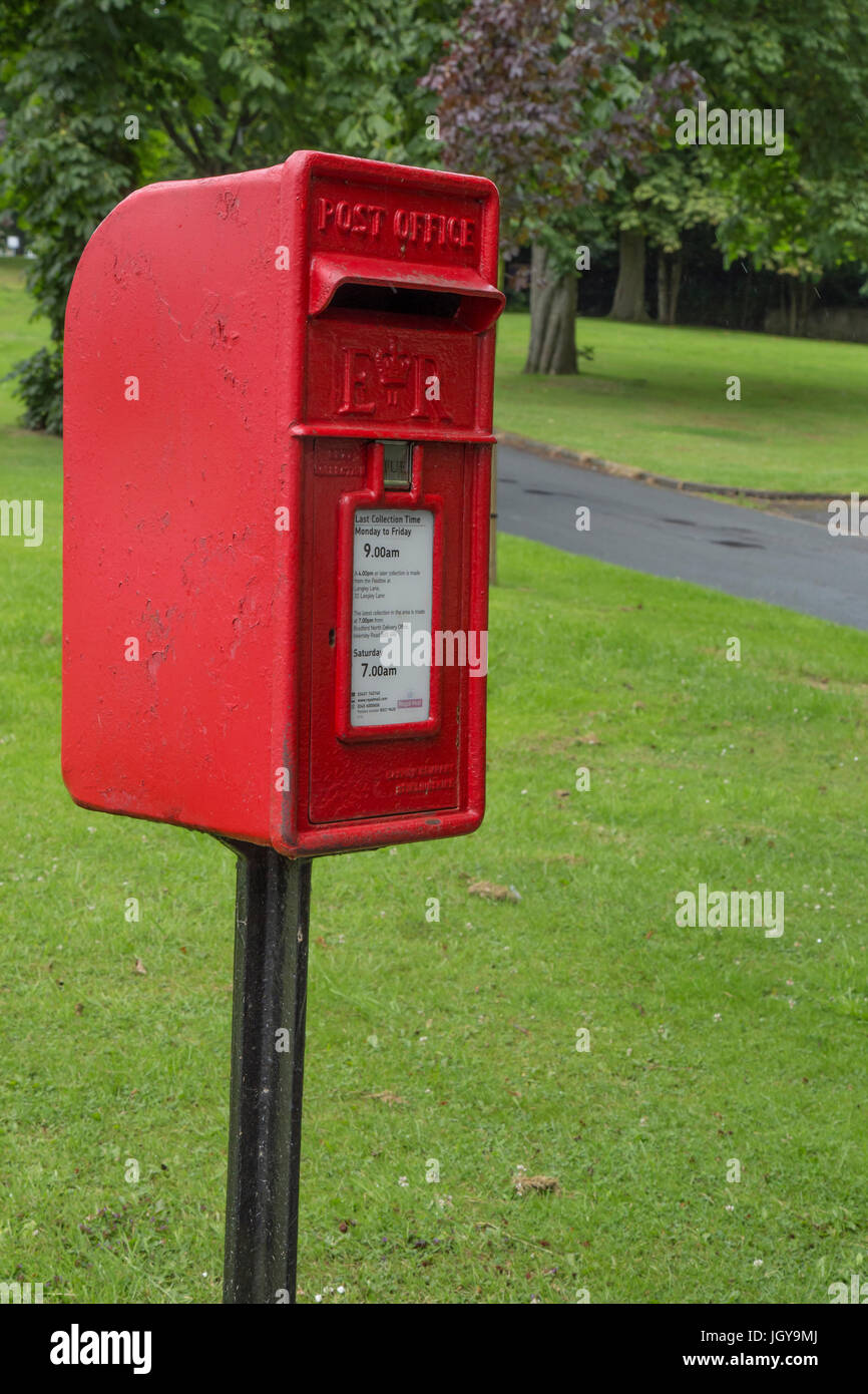 A red post box on a post - Stock Image