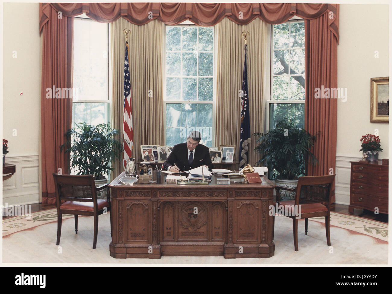 ronald reagan oval office. President Ronald Reagan At Work In The Oval Office Of White House N