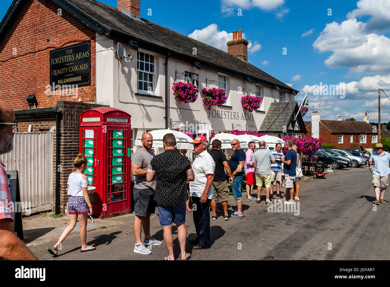 People Drinking Outside The Foresters Arms Pub, Fairwarp, East Sussex, UK - Stock Image