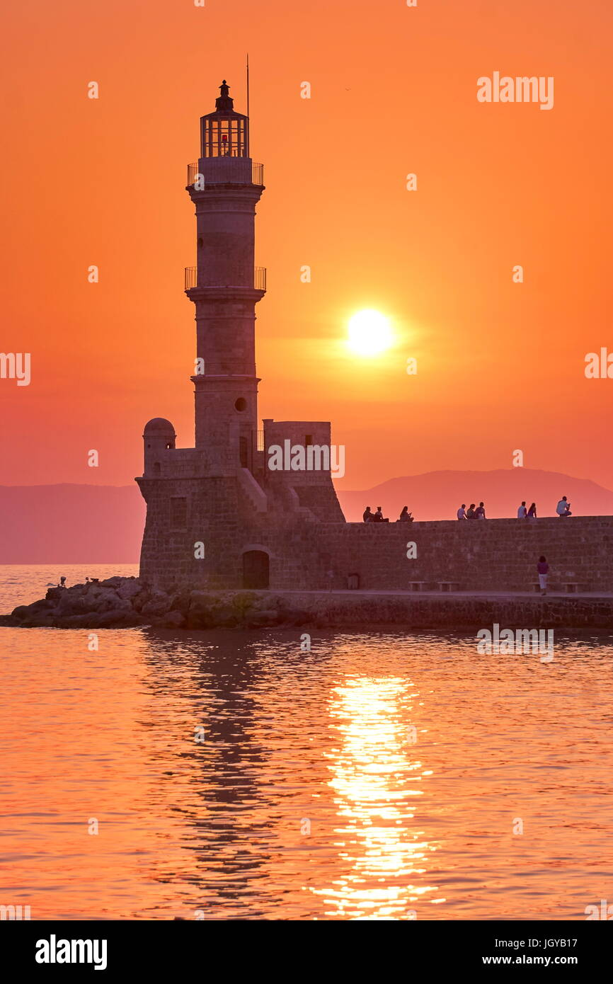 Chania - Lighthouse at sunset, Crete Island, Greece Stock Photo