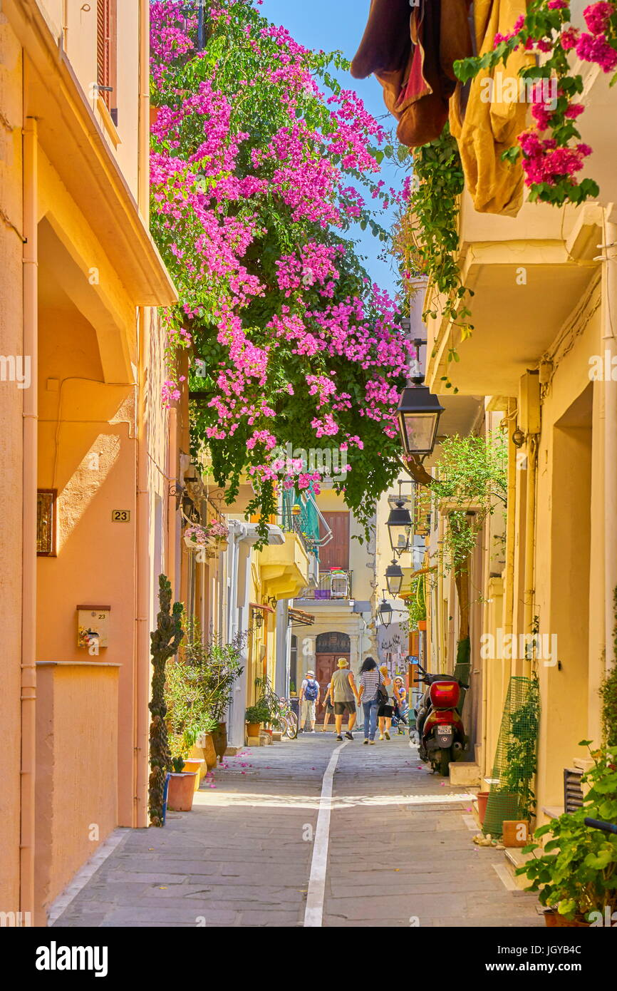 Rethymno old town street with blooming flowers decoration, Crete Island, Greece - Stock Image