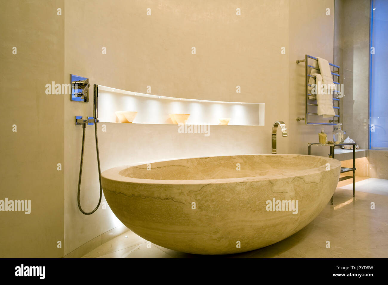 Stone bathtub at night - Stock Image