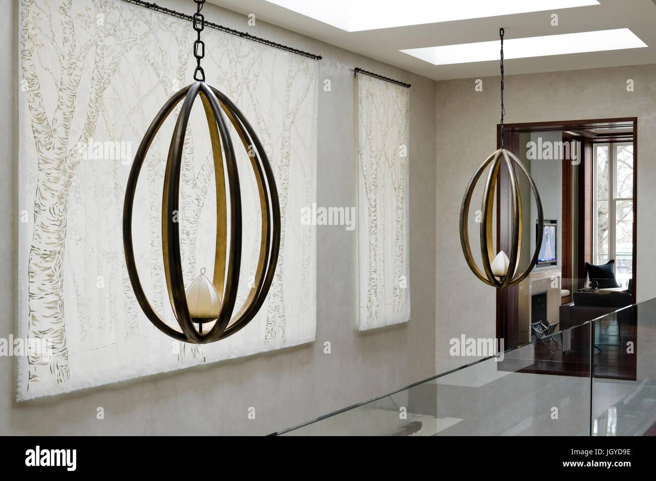 Pair of black pendant lights - Stock Image