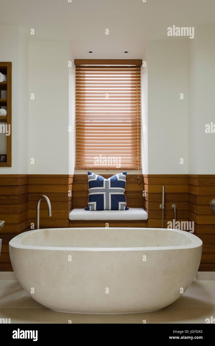 Stone bathtub with recessed bench Stock Photo: 148120621 - Alamy