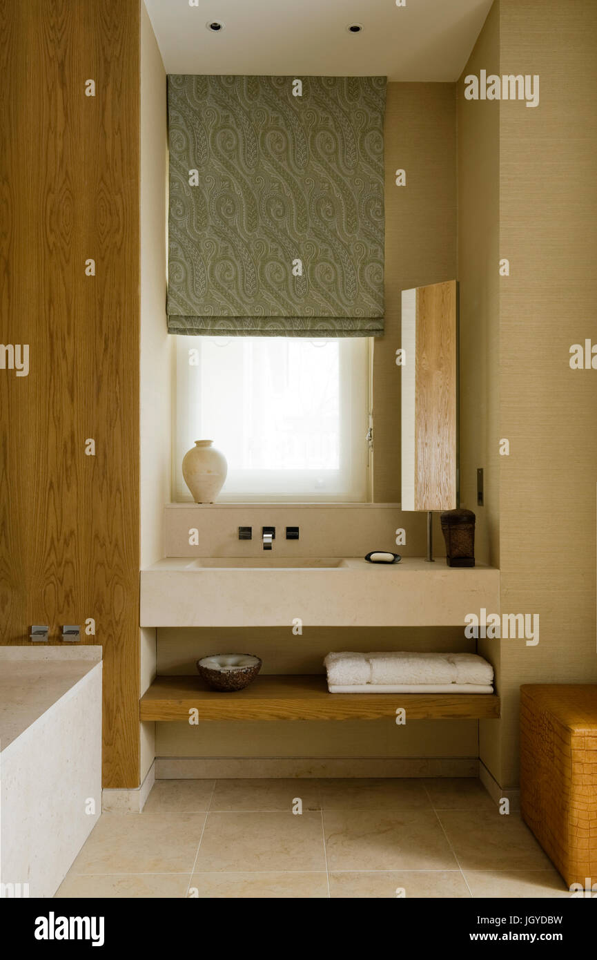 Bathroom sink by wood panelling - Stock Image