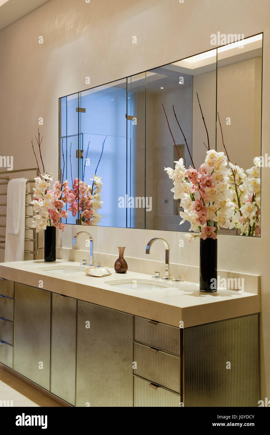 Pink And White Flowers In Bathroom Stock Photo Alamy