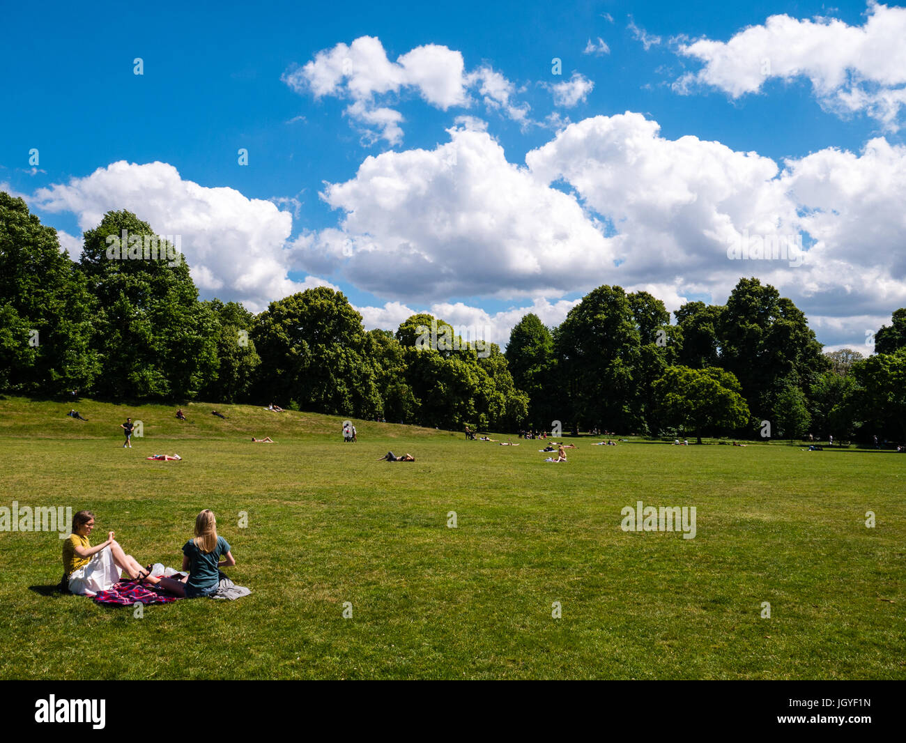 People Relaxing in Kensington Gardens, London, England - Stock Image